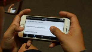"A user explores ""Cambodian Voter's Voice"", a new mobile app developed by Cambodia's election watchdog COMFREL, on August 27, 2015. (Hean Socheata/VOA Khmer)"
