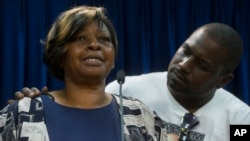 Audrey DuBose, mother of Samuel DuBose, is comforted by her son Aubrey as she speaks to the media after charges against a University of Cincinnati police officer were announced in the traffic stop shooting death of Samuel, July 29, 2015.