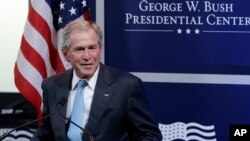 FILE - Former president George W. Bush speaks in Dallas, Texas, April 12, 2011.