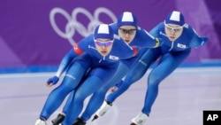 Team South Korea with Kim Bo-reum, front, Park Ji Woo, in second position, and Noh Seon-yeong, in last position, compete in the women's team pursuit speedskating race for seventh and eight place at the Gangneung Oval at the 2018 Winter Olympics in Gangneung, South Korea, Feb. 21, 2018.