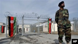 An Afghan National Army soldier stands in front of the gate of the newly refurbished Pul-e-Charkhy prison during an opening ceremony in Kabul, Afghanistan, March 2007 (file photo)