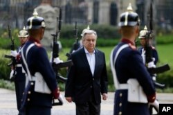 U.N. Secretary-General Antonio Guterres walks past an honor guard during a welcoming ceremony at the presidential palace in Bogota, Colombia, Saturday, Jan. 13, 2018.
