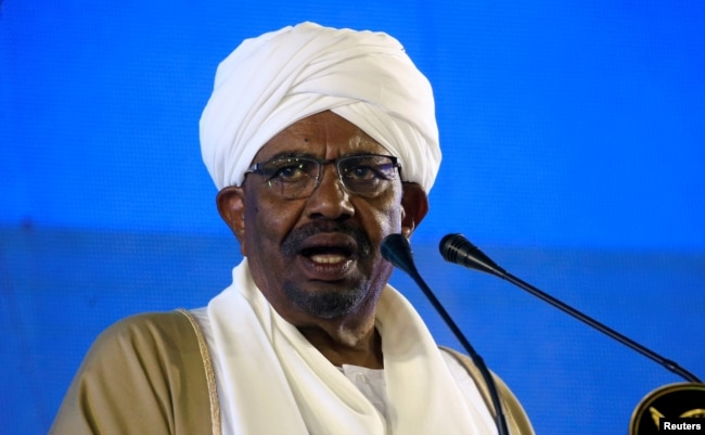 FILE - Sudan's President Omar al-Bashir delivers a speech at the Presidential Palace in Khartoum, Sudan, Dec. 31, 2018.