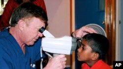 Dr. Jerry Beeve with a patient in Fiji
