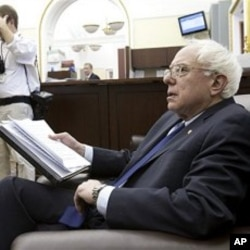 Sen. Bernie Sanders, D-Vt., speaks to reporters on Capitol Hill in Washington, March 10, 2011