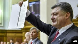 Ukraine Signs Pact with European Union