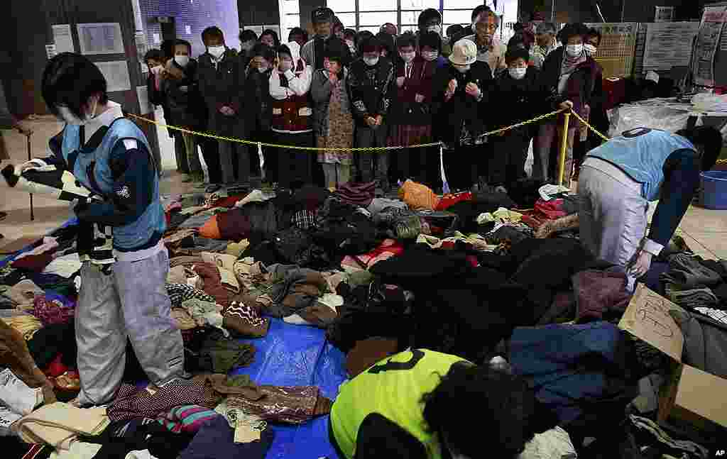 Evacuees wait to get second-hand clothing at a shelter for leaked radiation from the damaged Fukushima nuclear plant, on March 24, 2011. (AP)