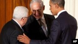 Shugaban Amurka Barack Obama da Shugaban Falasdinawa Mahmoud Abbas da Firayim Ministan Isira'ila Benjamin Netanyahu.