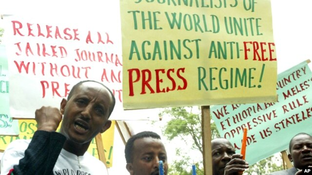 FILE - Ethiopian journalists hold placards as they shout slogans during a demonstration at the Ethiopian Embassy in Nairobi, May 2, 2006.