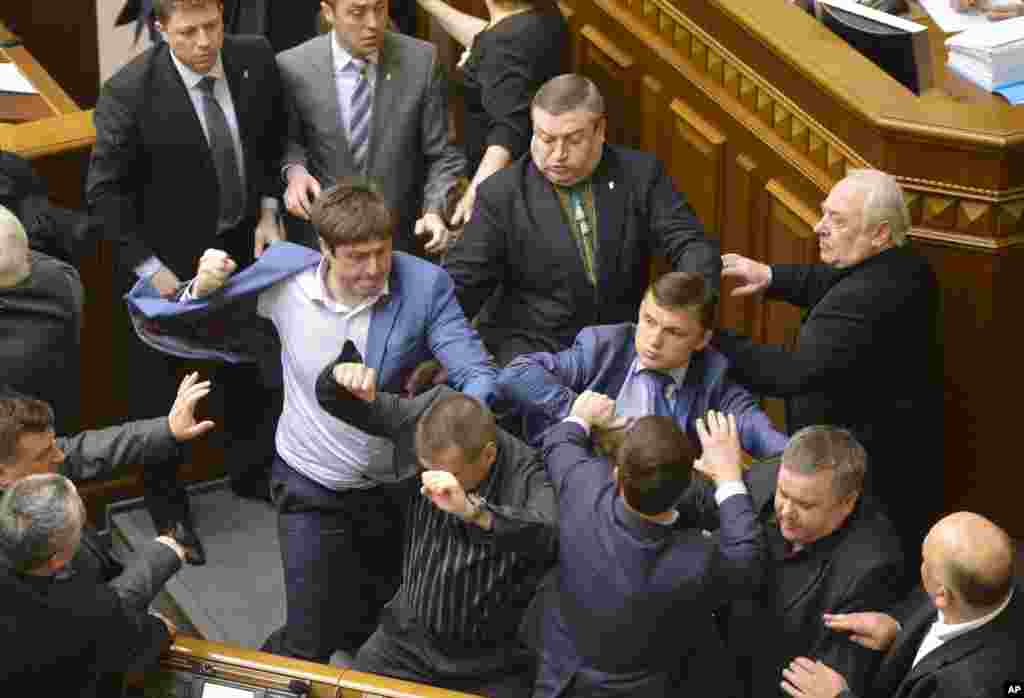 Communist lawmakers scuffle with right-wing Svoboda (Freedom) Party lawmakers during a session of the Ukrainian parliament in Kyiv, April 8, 2014.