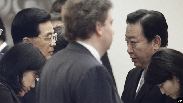In this image made from video Chinese President Hu Jintao, left, and Japanese Prime Minister Yoshihiko Noda speak on the final day of the APEC summit in Vladivostok, Russia, Sunday, Sept. 9, 2012.
