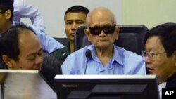 In this photo released by the Extraordinary Chambers in the Courts of Cambodia, Nuon Chea, center, who was the Khmer Rouge's chief ideologist and No. 2 leader, sits in the court room during a hearing at the U.N.-backed war crimes tribunal, in Phnom Penh, Oct. 17, 2014.