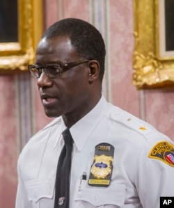 FILE - Cleveland Police Chief Calvin Williams answers questions during a news conference in Cleveland, Dec. 28, 2015.