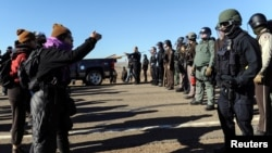 Police block the highway from protesters next to the pipeline route during a protest against the Dakota Access pipeline near the Standing Rock Sioux Reservation in St. Anthony, N.D., Nov. 11, 2016.