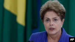 Brazil's President Dilma Rousseff, speaks during ceremony to introduce an anti-corruption package to Congress in the wake of mass protests calling for an end to graft and her impeachment, at the Planalto Presidential Palace in Brasilia, March 18, 2015.