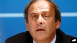 FILE - UEFA President Michel Platini delivers his speech during a press conference after the soccer Europa League draw ceremony at the Grimaldi Forum, in Monaco, August 28, 2015.