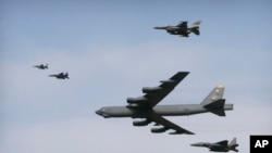 A U.S. Air Force B-52 bomber flies over Osan Air Base in Pyeongtaek, South Korea, Jan. 10, 2016. The bomber flew low over South Korea on Sunday, a show of force from the U.S. as a Cold War-style standoff deepened between ally Seoul and North Korea.