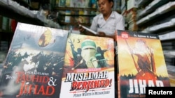 FILE - A vendor displays books written about jihad in an Islamic book store in Jakarta.