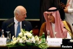 Saudi Foreign Minister Adel al-Jubeir, right, speaks with U.N. Special Envoy for Syria Staffan de Mistura during a Syrian opposition meeting in Riyadh, Saudi Arabia, Nov. 22, 2017.