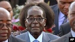 FILE: Zimbabwean president, Robert Mugabe, center, arrives in Pretoria, South Africa Tuesday, April 7, 2015.