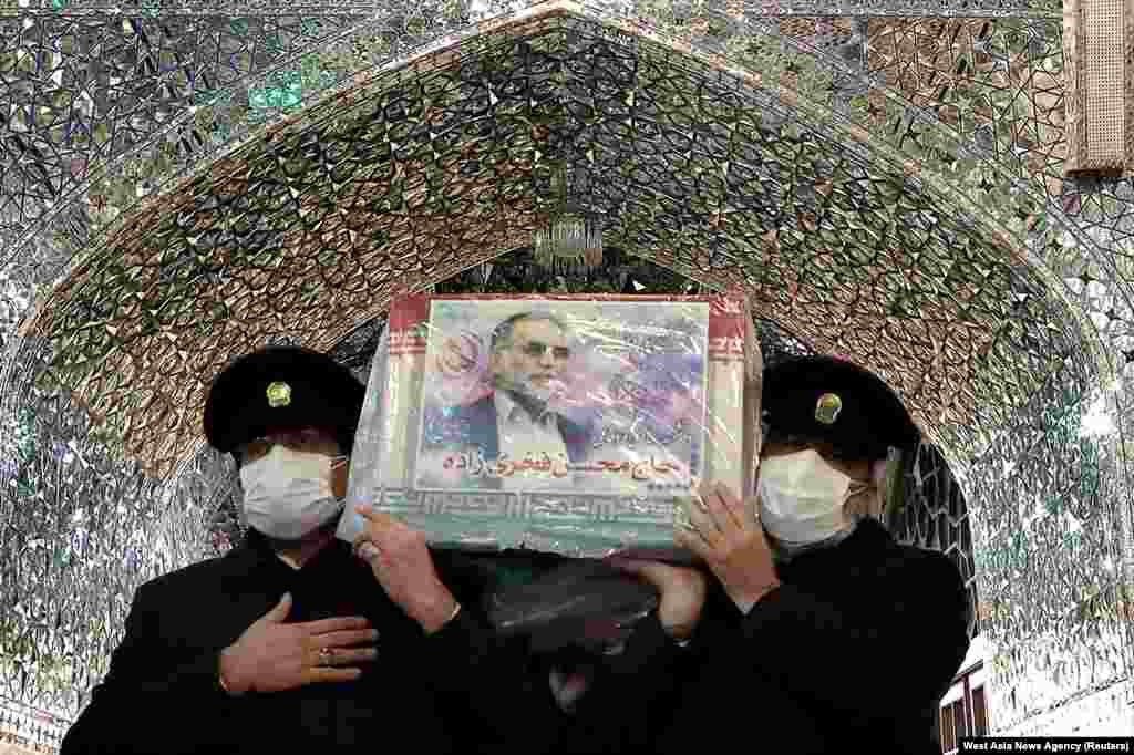 Servants of the holy shrine of Imam Reza carry the coffin of Iranian nuclear scientist Mohsen Fakhrizadeh, in Mashhad.