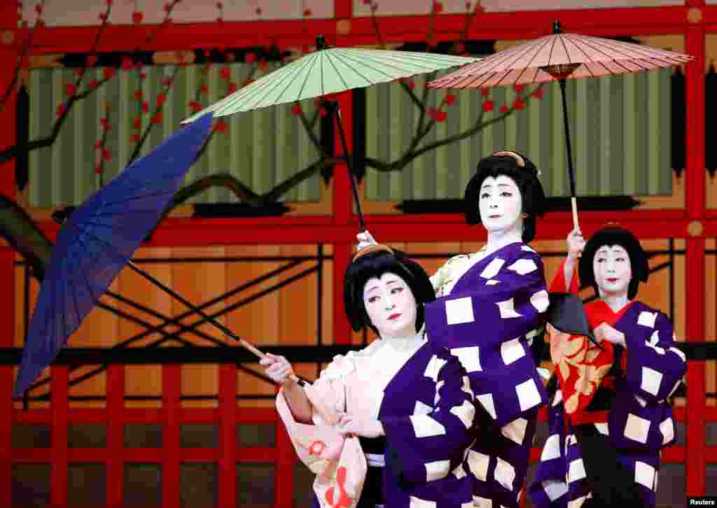 Geishas, traditional Japanese female entertainers, perform their dance during a press preview of the annual Azuma Odori Dance Festival at the Shinbashi Enbujo Theater in Tokyo, Japan.