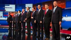 Republican presidential candidates from left, Chris Christie, Marco Rubio, Ben Carson, Scott Walker, Donald Trump, Jeb Bush, Mike Huckabee, Ted Cruz, Rand Paul, and John Kasich take the stage for the first Republican presidential debate at the Quicken Loa