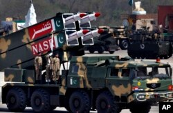 A Nasr missile is loaded on vehicle during the Pakistan National Day parade in Islamabad, Pakistan, March 23, 2015.