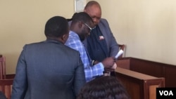 Job Sikhala and his lawyers in court ...