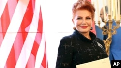 FILE - Georgette Mosbacher is seen after receiving her credentials as new United States ambassador to Poland in Warsaw, Sept. 6, 2018.
