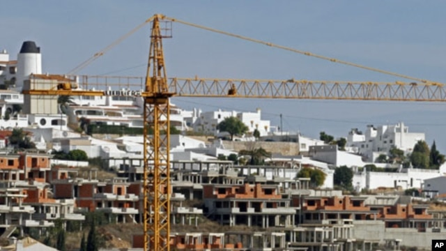 A crane is seen over an abandoned tourist resort construction in Gale on the southern Portuguese province of Algarve, March 6, 2012.