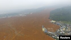 An aerial view shows the site of a landslide which hit an industrial park in Shenzhen, Guangdong province, China, December 21, 2015.