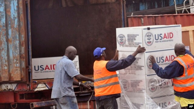 FILE - American aid goods are loaded onto a truck after it arrived by airplane, to be used in the fight against the Ebola virus spreading in the city of Monrovia, Liberia, Aug. 24, 2014.