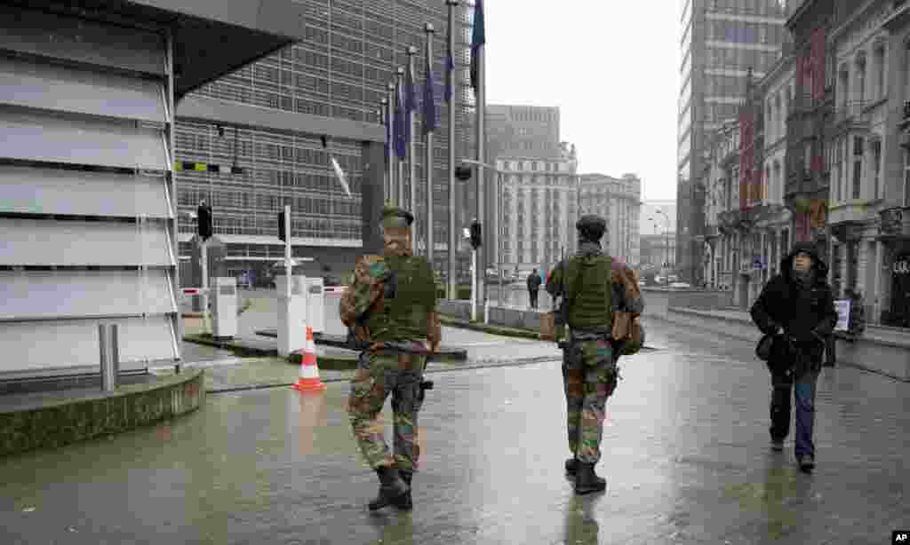 In the midst of heightened security, soldiers patrol the EU headquarters in Brussels, Belgium, Jan. 19, 2015.