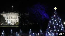 The National Christmas Tree is pictured with the White House in the background after it was lit on the Ellipse across from the White House in Washington, Thursday, Dec., 1, 2011