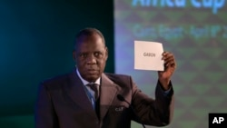 FILE - President of the Confederation of African Football, Issa Hayatou, announces that Gabon will be hosting the 2017 African Cup of Nations, April 8, 2015.