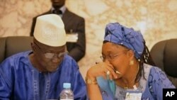 President of the electoral committee of Guinea Ben Sekou Sylla (L) speaks with president of the national transition council Rabiatou Sera Diallo during a meeting of political party leaders on the eve of presidential elections in Conakry (File Photo - 26 J