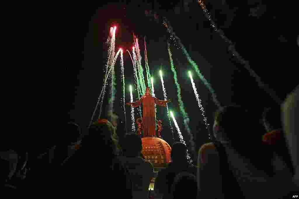 Fireworks explode as the new lights of the Christ King statue are inaugurated remotely by Pope Benedict . (AP)
