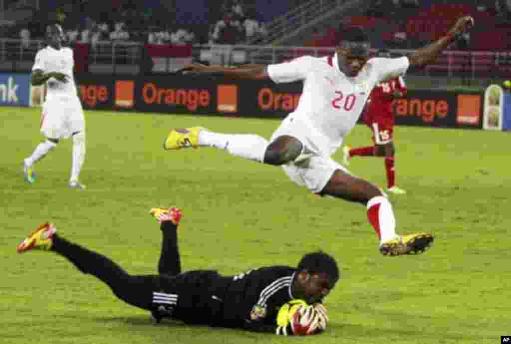 "Sudan's goalkeeper Akram El Hadi Salim saves the ball from Issiaka Ouedraogo of Burkina Faso during their African Nations Cup Group B soccer match at Estadio de Bata ""Bata Stadium"", in Bata January 30, 2012."