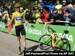 Britain's Chris Froome reacts after he crashed at the end of the twelfth stage of the Tour de France cycling race
