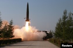 FILE - A missile is launched during a military drill in North Korea, in this May 10, 2019, photo supplied by the Korean Central News Agency.