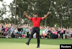 FILE - Tiger Woods celebrates on the 18th hole to win the 2019 Masters. (REUTERS/Lucy Nicholson/File Photo)