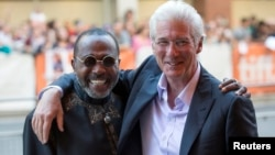 "Richard Gere (R) hugs Ben Vereen as they arrive for the ""Time Out of Mind"" gala at the Toronto International Film Festival (TIFF) in Toronto, Canada, Sept. 7, 2014."