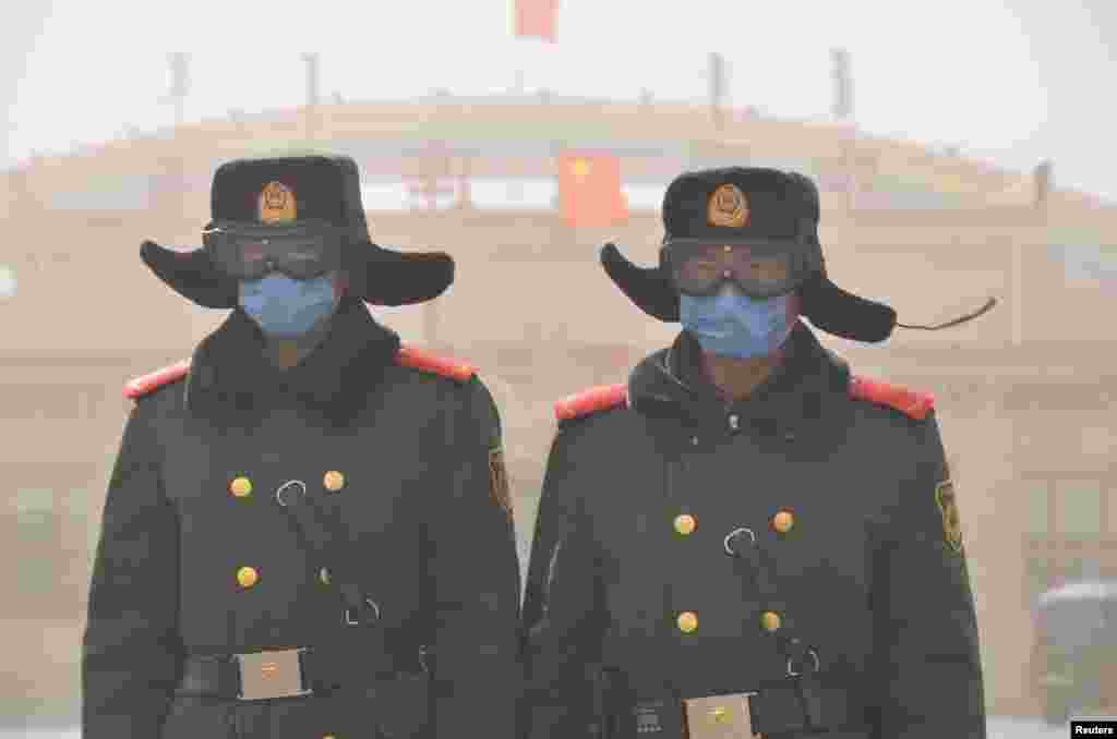 Soldiers of the People's Liberation Army (PLA) stand guard as sand blows in Xilin Gol League, Inner Mongolia Autonomous Region, China.