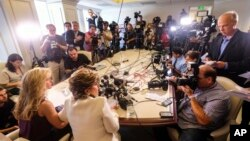 "Summer Zervos, foreground left, alongside her attorney, addresses the media during a news conference in Los Angeles, Oct. 14, 2016. Zervos, a former contestant on ""The Apprentice"" says Republican presidential candidate Donald Trump made unwanted sexual advances toward her in 2007."