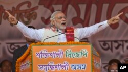 Indian Prime Minister Narendra Modi addresses a youth rally organized by the Bharatiya Janata Party ahead of Assam state elections in Gauhati, India, Jan. 19, 2016.