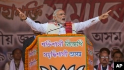FILE - Indian Prime Minister Narendra Modi addresses a youth rally. Modi has ordered a multi-agency investigation into the Panama Papers expose.