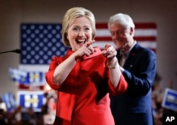 Democratic presidential candidate Hillary Clinton greets supporters with her husband, former President Bill Clinton, at a Nevada Democratic caucus rally in Las Vegas, Feb. 20, 2016.