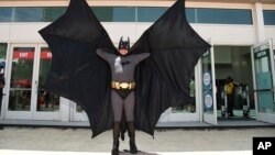 FILE - Howard Gemsler of Irvine dresses as Batman at Comic-Con, in Sand Diego, July 20, 2017.