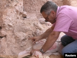 Dr. Jean-Jacques Hublin points out the new finds at Jebel Irhoud in Morocco in this undated handout photo obtained by Reuters, June 7, 2017.